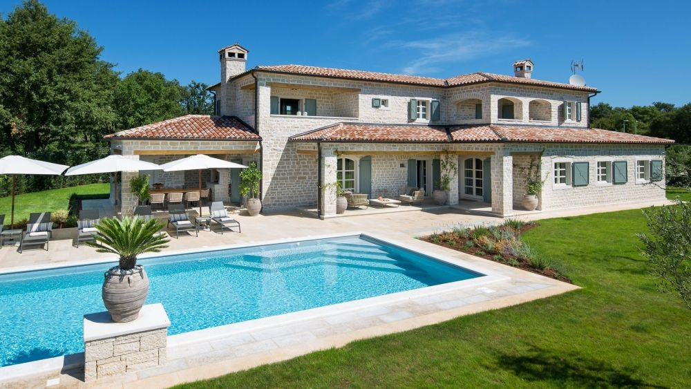 - villa with pool - superb designer interiors - near Kanfanar/Rovinj area - estate with 4 luxury villas, playground, sport centre - number of rooms - 6 - number of bathrooms - 7 - number of bedrooms - 5  - large yard, private pool, parking - airconditioned, wifi internet
